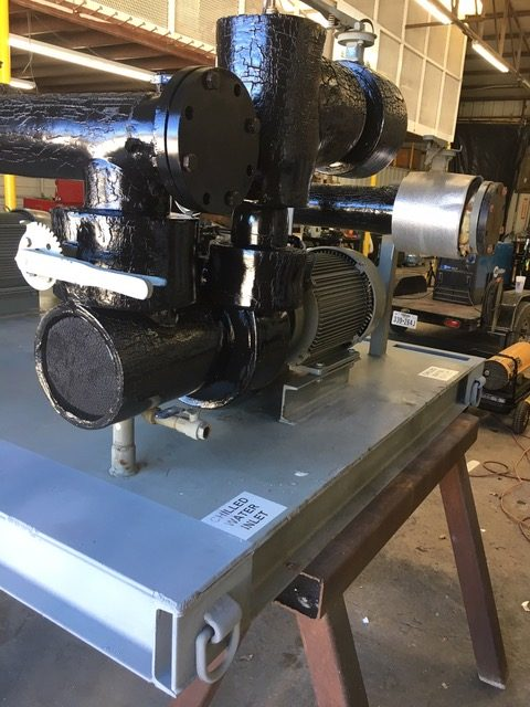 Two used Bell & Gossett 15HP Pumps skid mounted with Suction Diffusers, Isolation Valves, and Supply and Return Headers